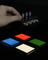 Red, green, blue and white OLED panels with a dimmable driver