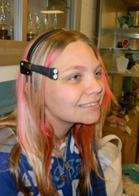 "Student wears the Daysimeter to monitor her rest and activity patterns and the amount of ""circadian light"" reaching her eyes."