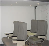 Photo: Experimental setup of a mock airplane passenger cabin with reading lights.