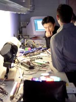 Photo of students from a previous LED Institute ponder their lighting project