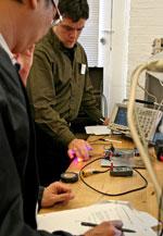 Photo: Institute participants experiment with LEDs.