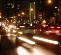 Photo of car headlights at night