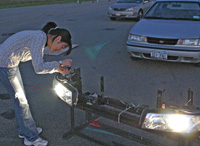 LRC researcher adjusts headlamp test apparatus