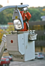 Photo of utility worker and streetlight