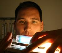 Photo: Student examining fluorescent lamp