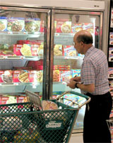 Photo: Supermarket customer in freezer aisle